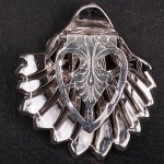 1930s Dress clip in a shell shape with diamante and an etched clip - back