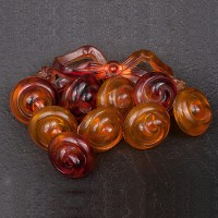 1930s Lucite brooch in amber tone with a bow and dangly button shapes