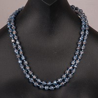 1950s single row blue mottled glass necklace displayed as two