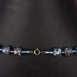 1950s single row blue mottled glass necklace displayed as two - clasp