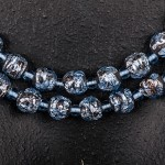 1950s single row blue mottled glass necklace displayed as two - detail