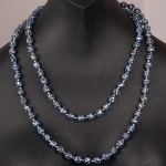 1950s single row blue mottled glass necklace displayed as two - spaced