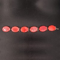 1960s coral tone lucite bracelet set in silver tone metal