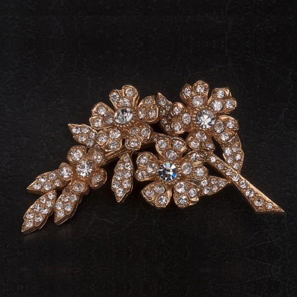 1980s diamante spray brooch set in goldtone metal by SARDI